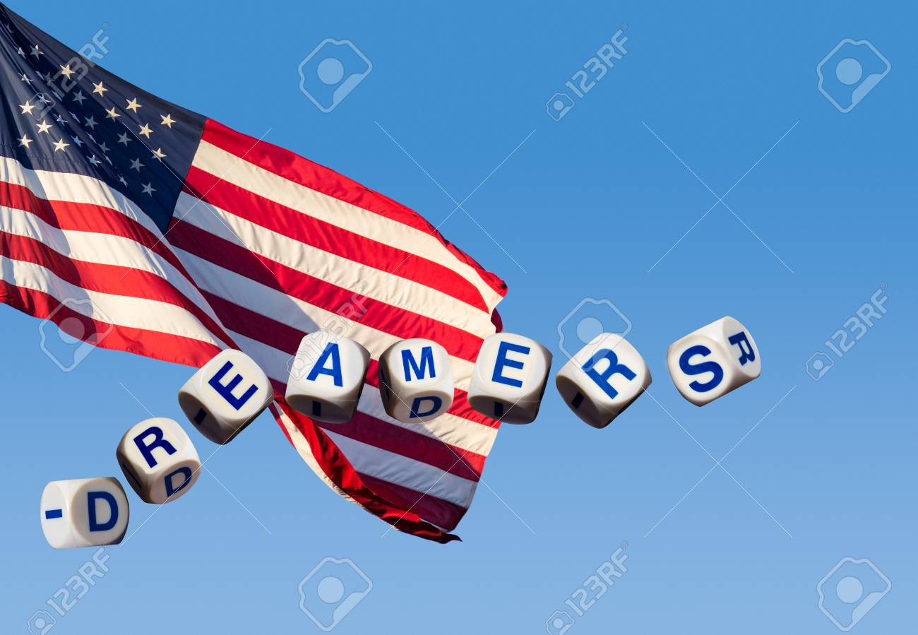 Dreamers children spelling letters on blue sky and USA flag to illustrate dreaming of the future - 94251049