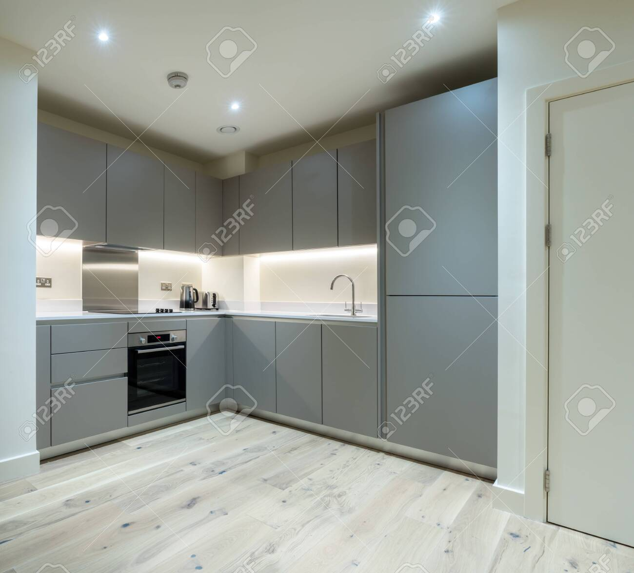 Clean new apartment kitchen in gray with modern appliances and..
