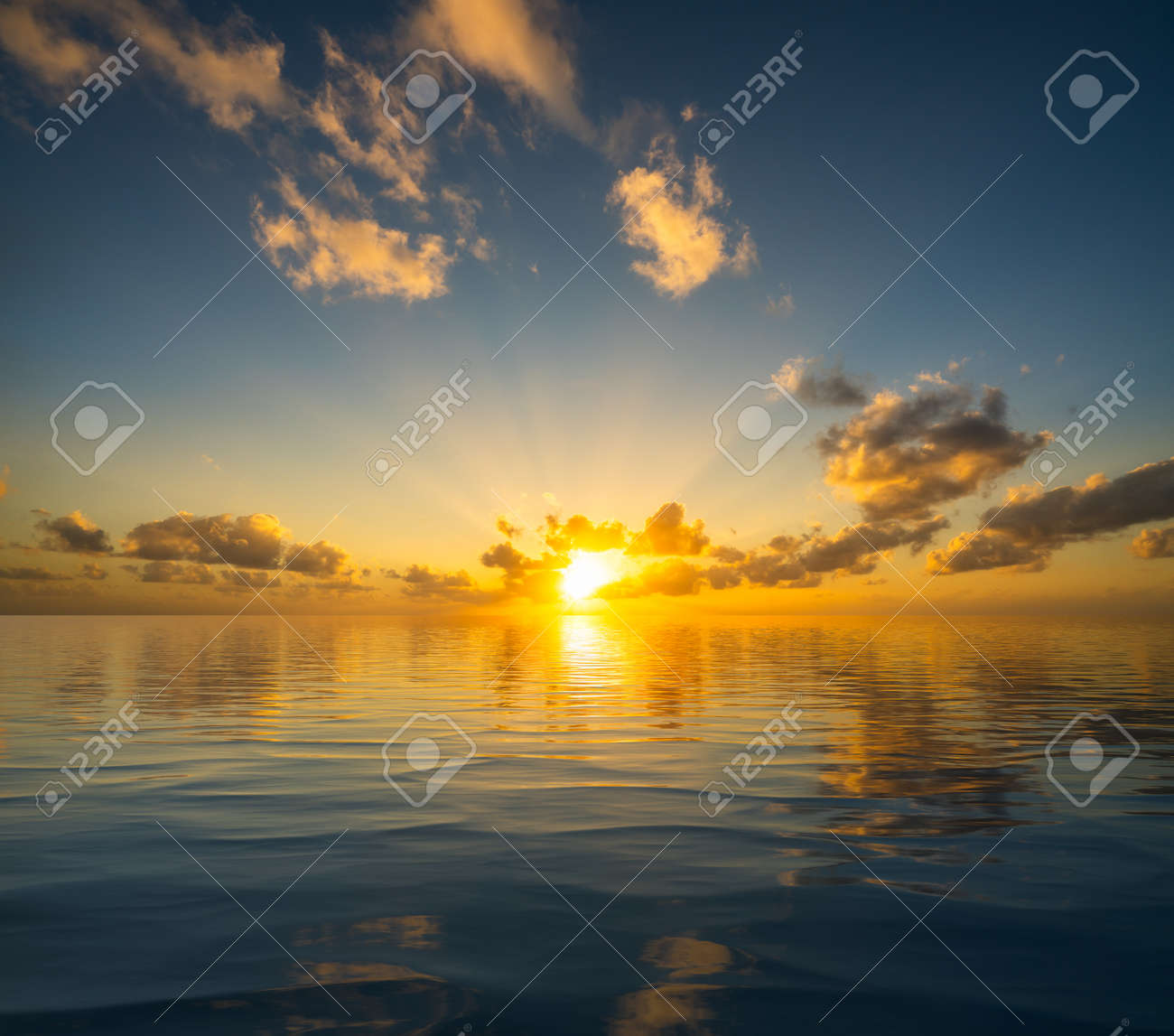 Dramatic sunrise or sunset reflected into the calm waters of an artificial ocean to represent peace or heaven - 154950427
