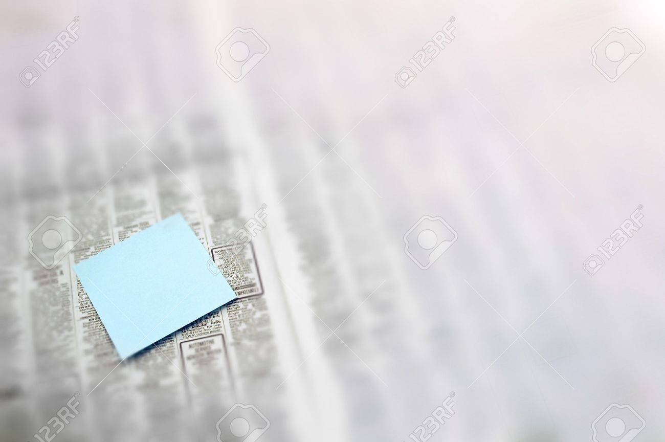 Post-It note in newspaper Stock Photo - 229987