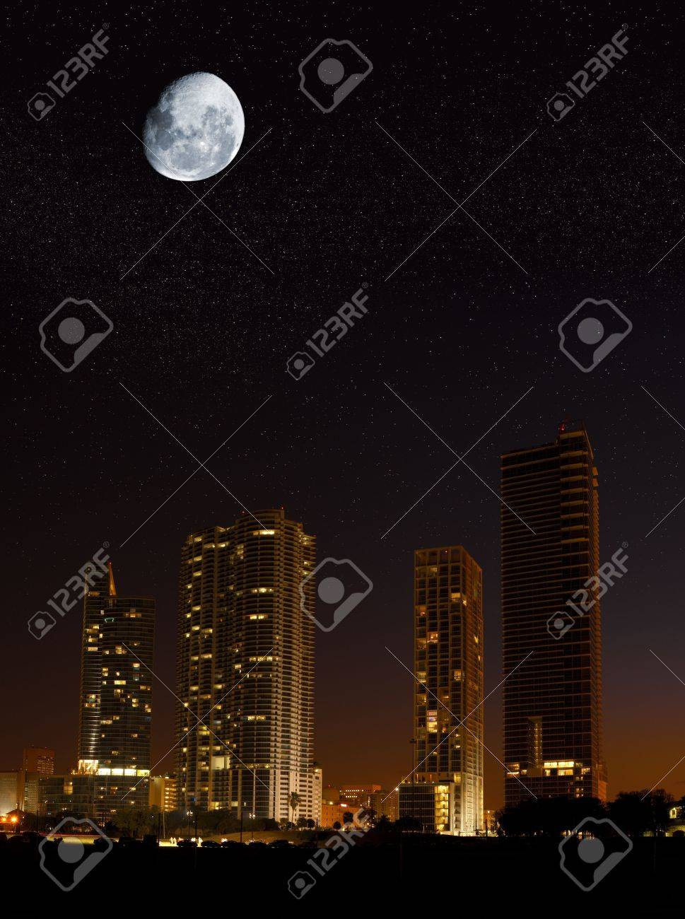 Night in the city - moon showing in the sky over skyscrapers Stock Photo - 4663727
