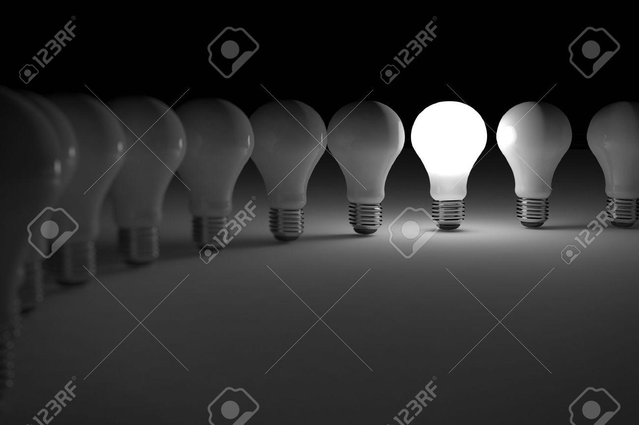 One lit light bulb amongst other broken light bulbs Stock Photo - 9038091