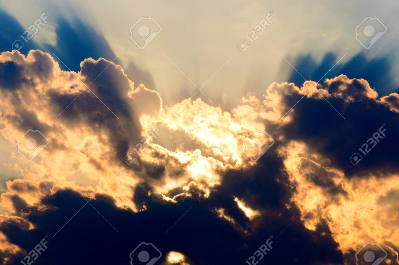 Sunset under the abstract clouds Stock Photo - 14442329