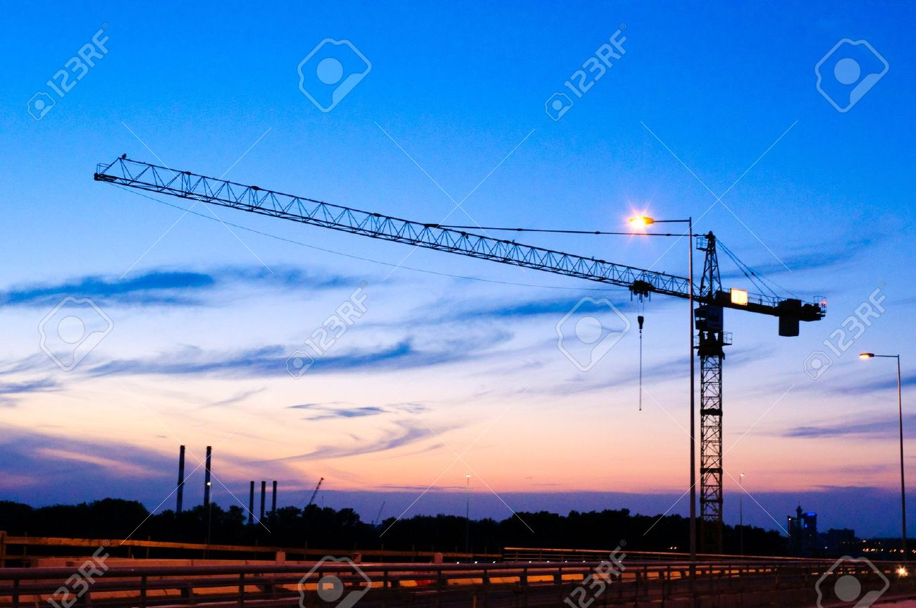 single cran at night on construction site stock photo picture and