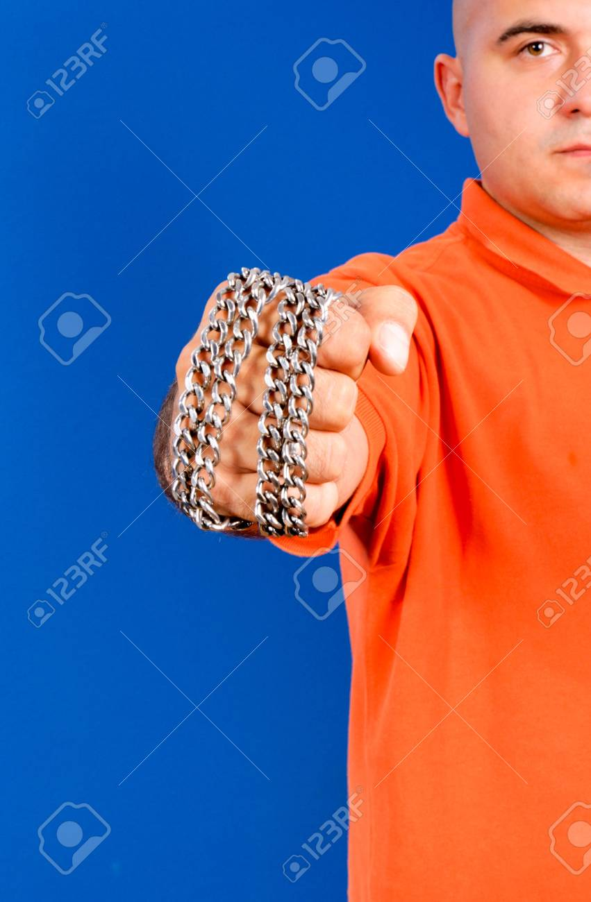 Fist with the metal chail Stock Photo - 15045555