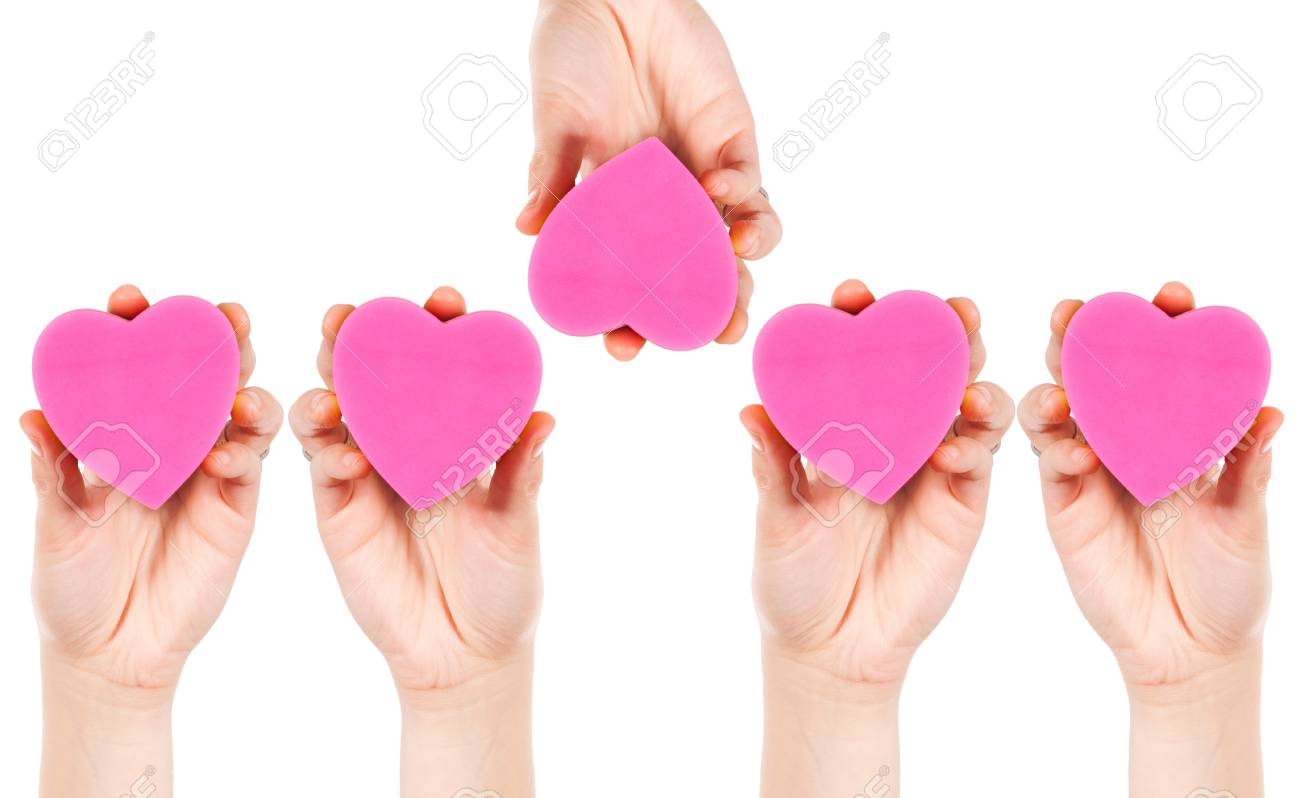 Hands holding the heart papers isolated on white background Stock Photo - 17390791