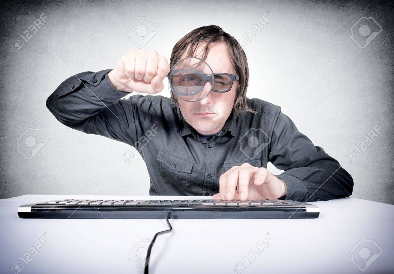 Searching concpet with the man holding magnifier Stock Photo - 20760928