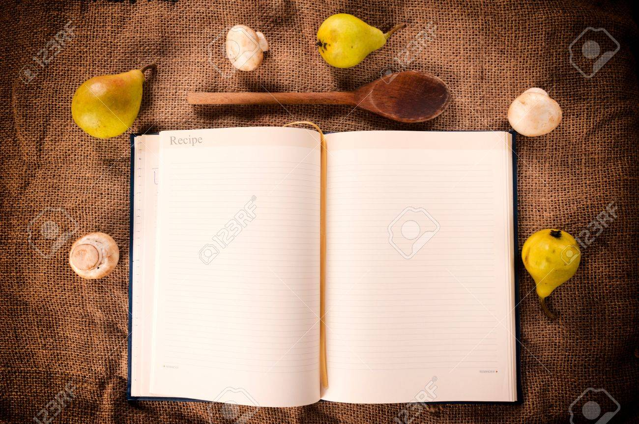 Cookbook with mushrooms and pear from above Stock Photo - 20917000