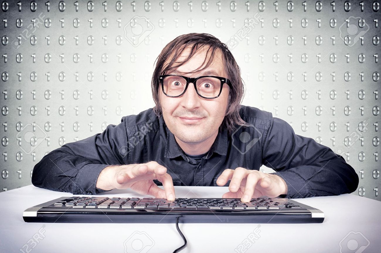 Funny hacker typing on the keyboard Stock Photo - 20934336