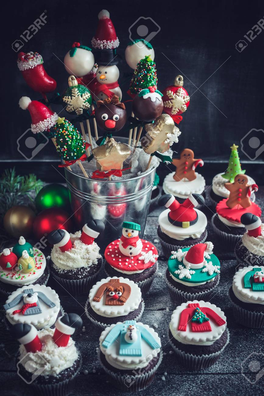 Christmas Cake Pops.Christmas Cake Pops And Cupcakes On Dark Background Selective