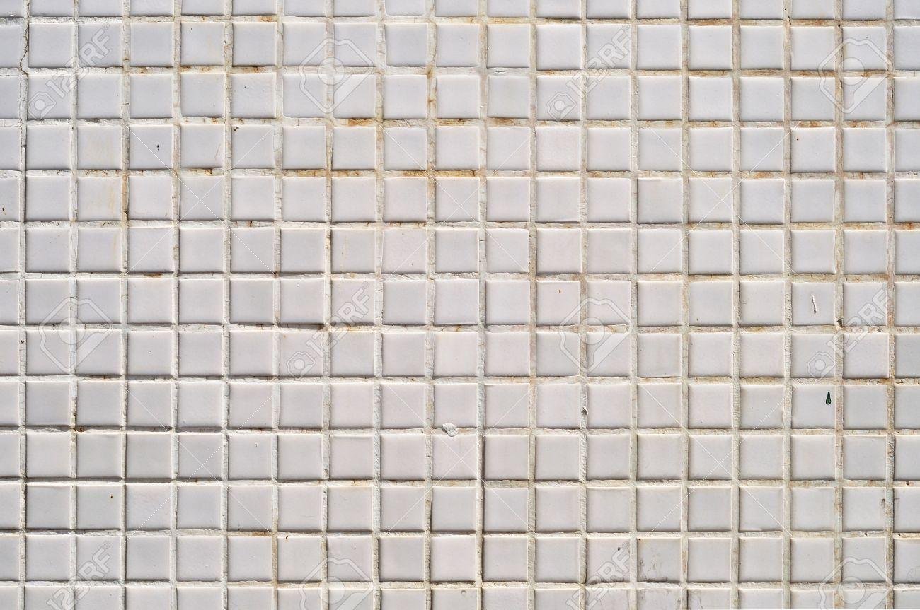 Grungy white square ceramic tiles texture stock photo picture and grungy white square ceramic tiles texture stock photo 13080810 dailygadgetfo Gallery