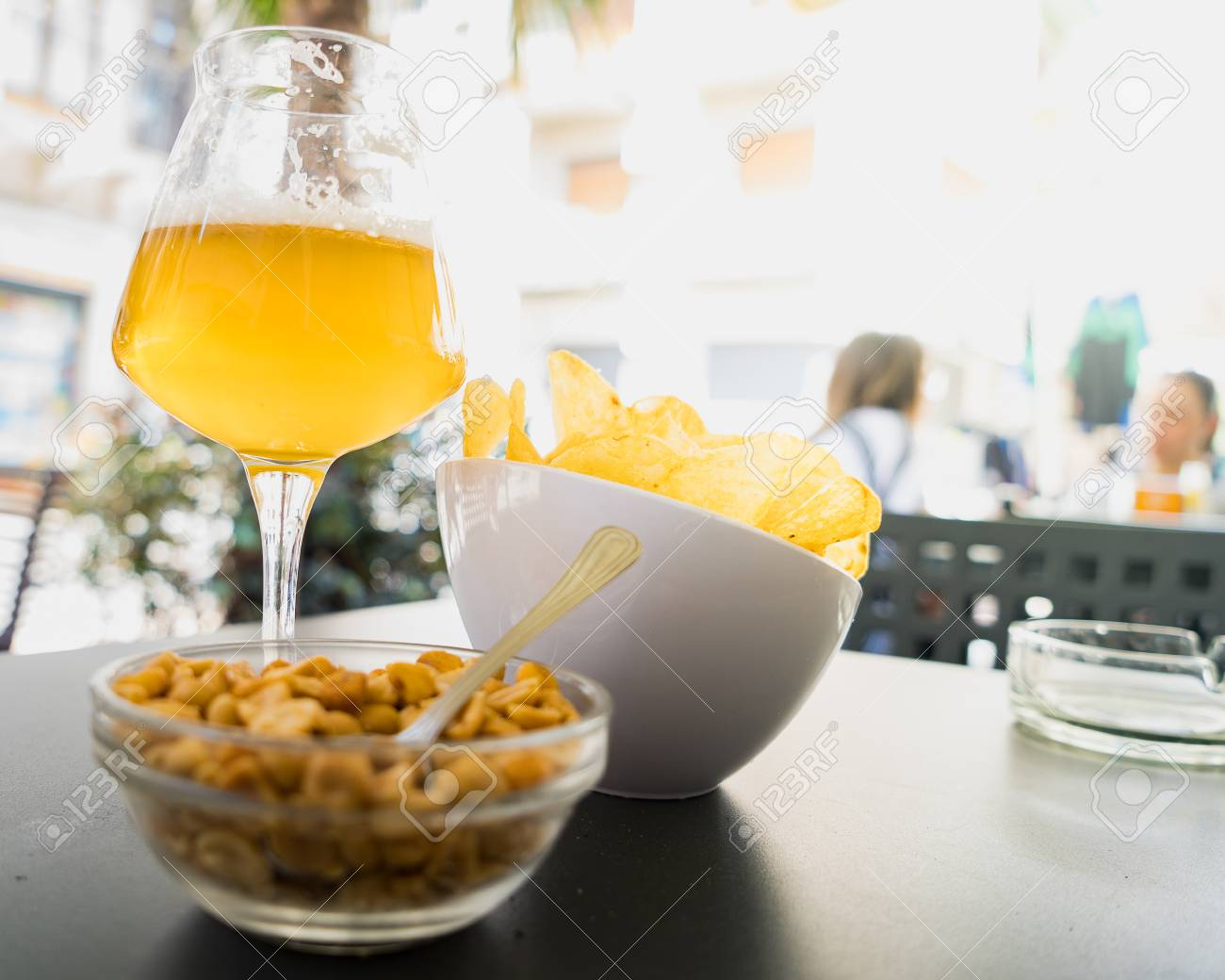 Aperitif beer and chips on an open air snack bar table stock photo aperitif beer and chips on an open air snack bar table stock photo 100931649 watchthetrailerfo