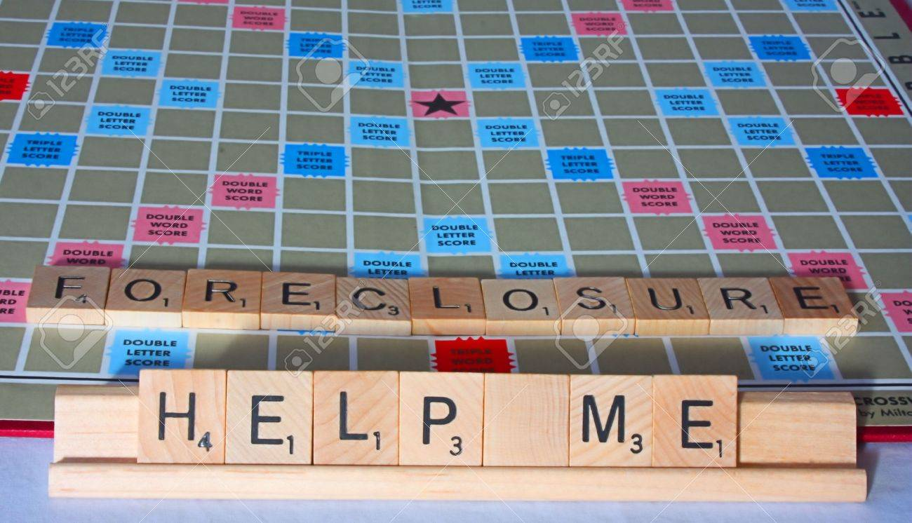 A cry for financial help spelled out on a board game. Stock Photo - 12358307
