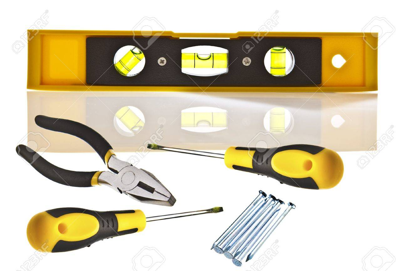 yellow spirit level iwth tools and copy space stock photo picture