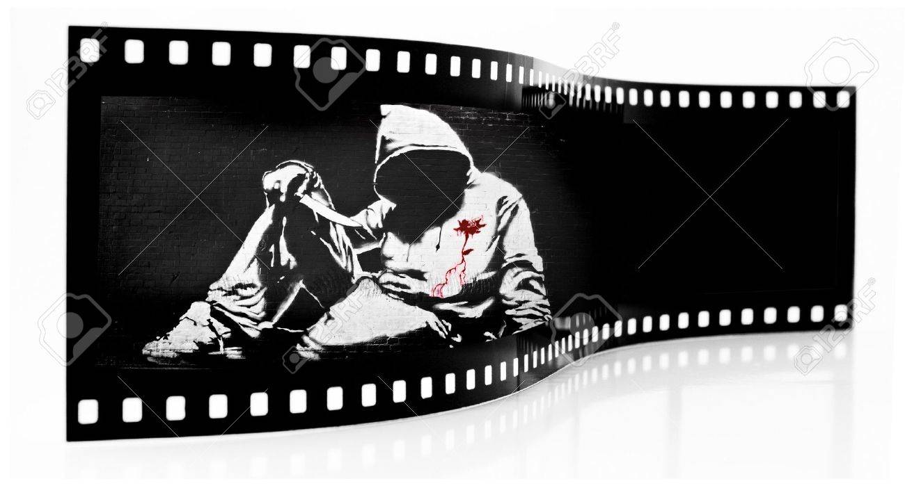 Banksy Hoodie with Knife Graffiti film strip Stock Photo - 5500146