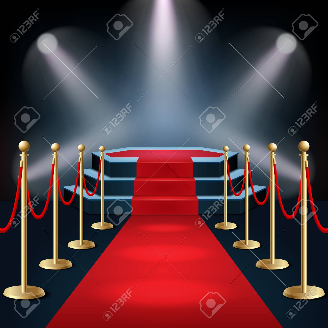 Podium with red carpet and barrier rope in glow of spotlights - 101191237