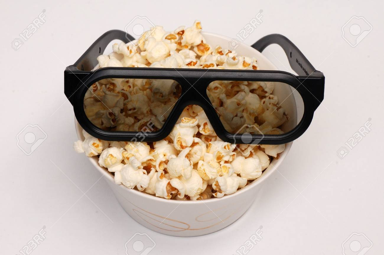 The little vessel is full of pop-corn, and these are the 3D glasses on the pop-corn Stock Photo - 13830172