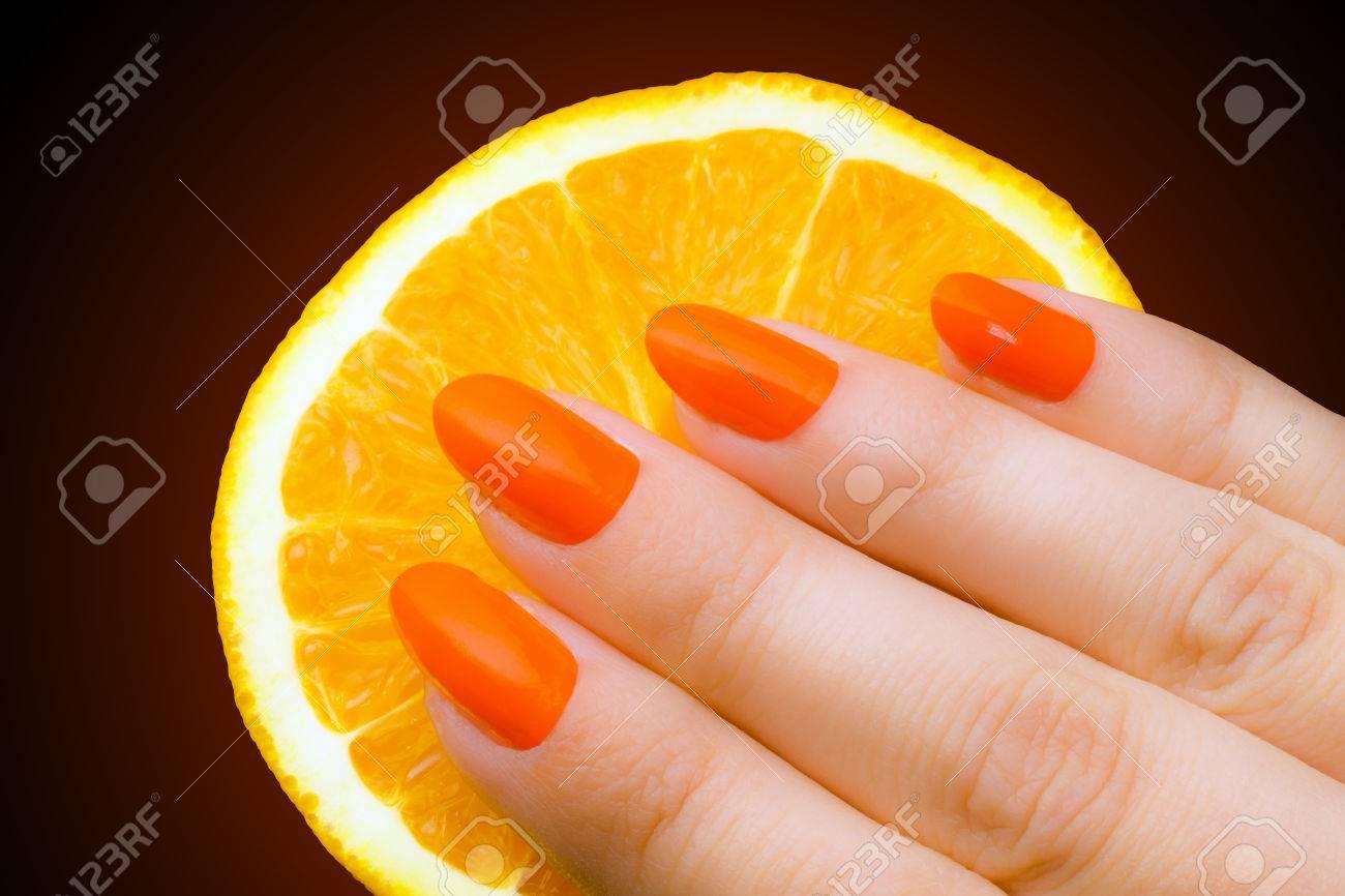 Orange Nails With Orange Fruit On Dark Background. Stock Photo ...