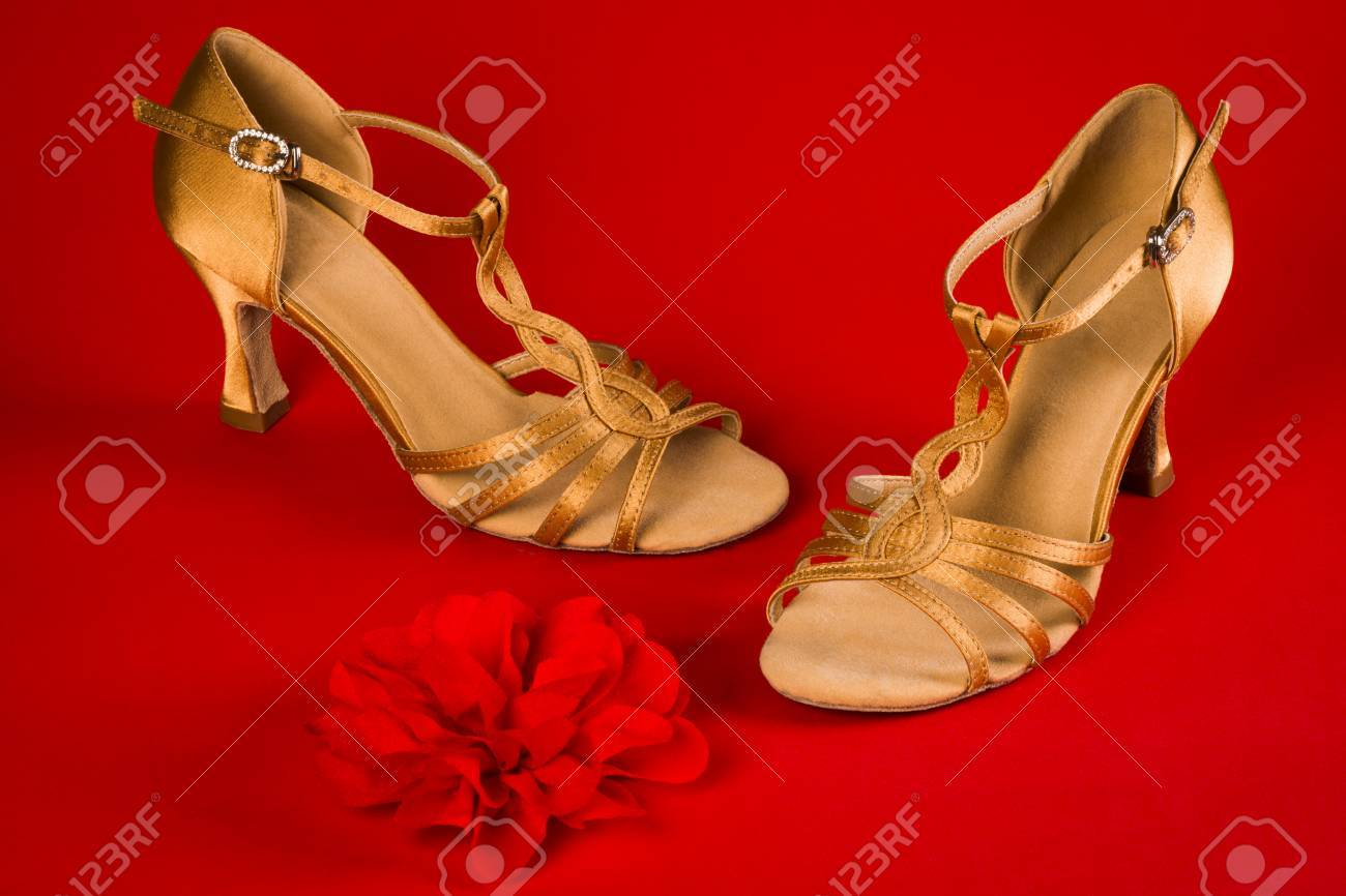 d81973ee4 Golden Latin Dance Shoes Are On Red Background. Stock Photo, Picture ...