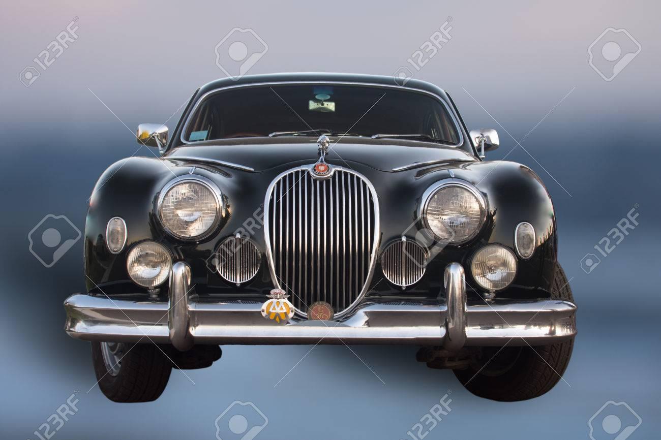 Old Black Jaguar Car Old Timer On Blue Background Stock Photo