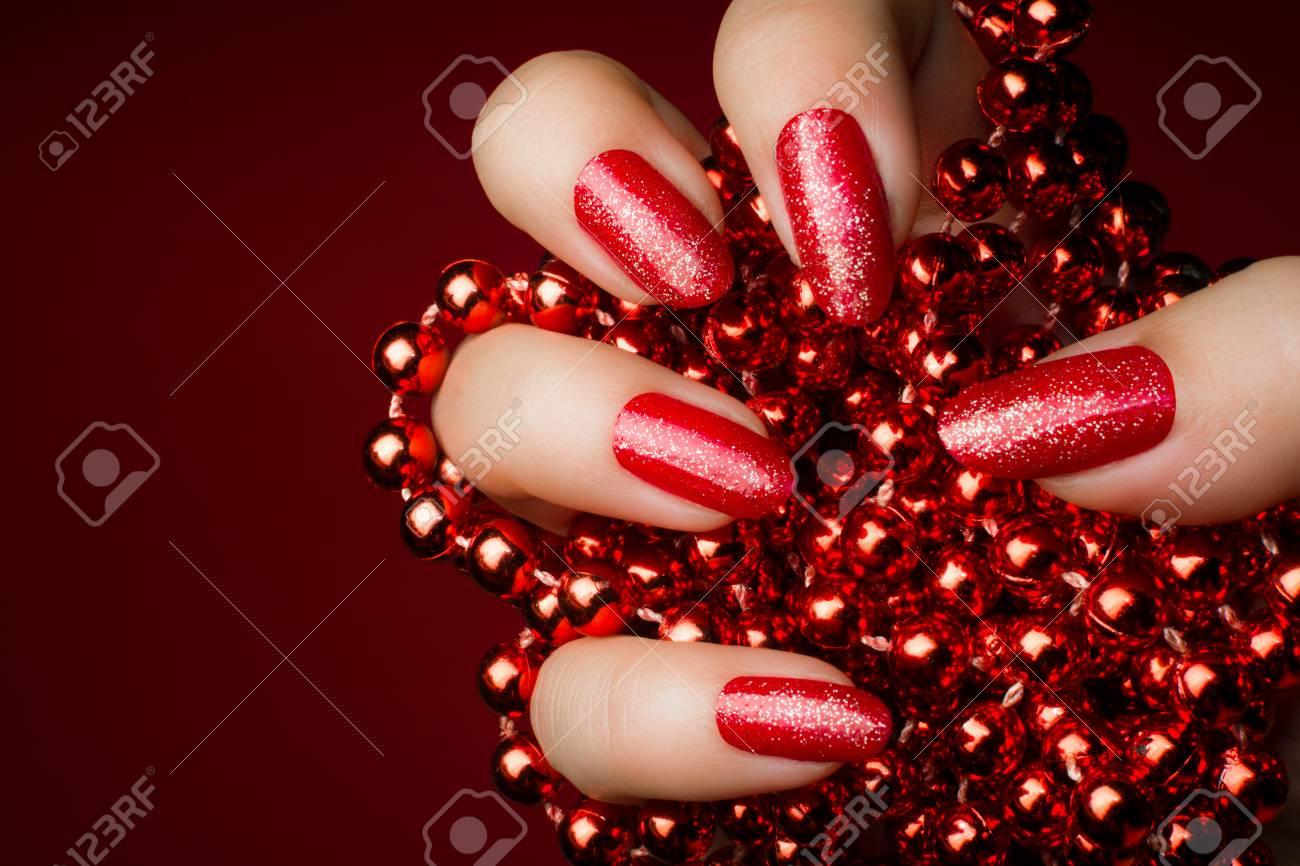 dark red nail polish with glitter