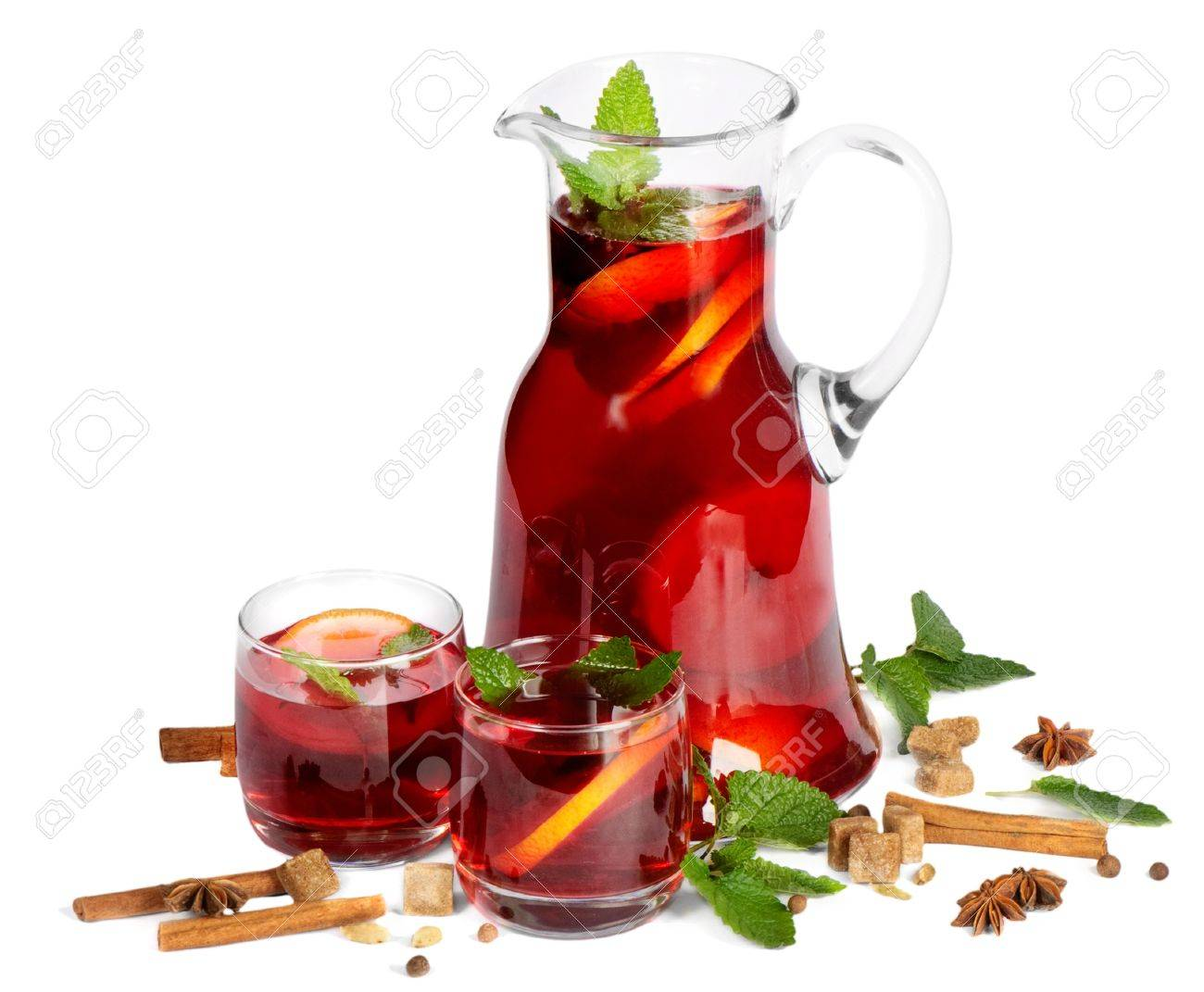 Fruit drink in jug and two glasses. Isolated on white Stock Photo - 10034540