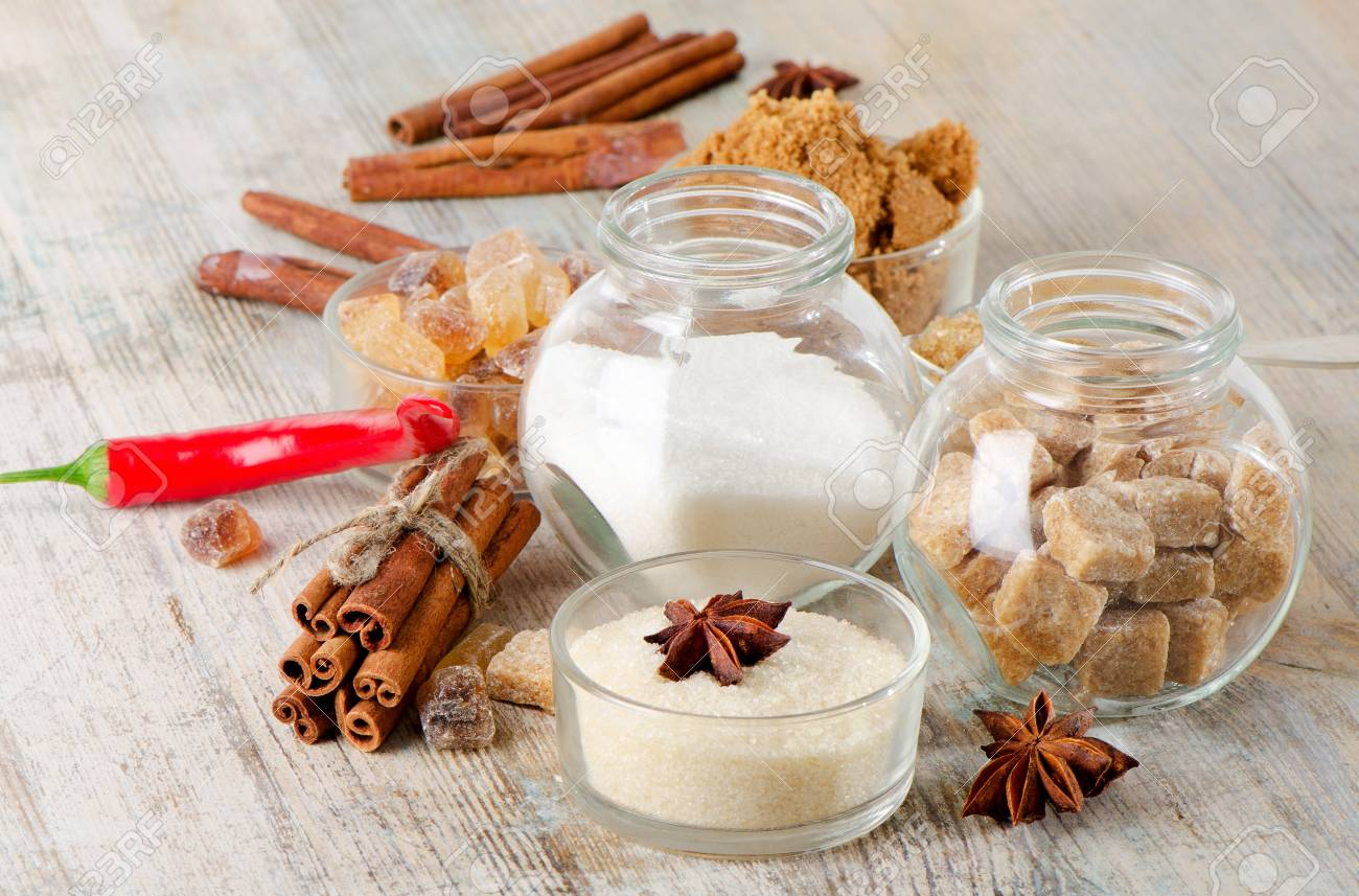 Sugar and spices  on a wooden table Stock Photo - 17850505
