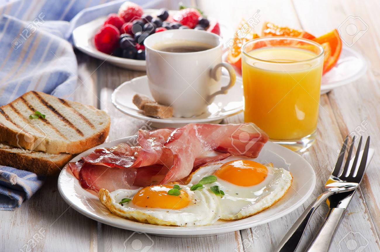 coffee cup two eggs and bacon for healthy breakfast stock photo