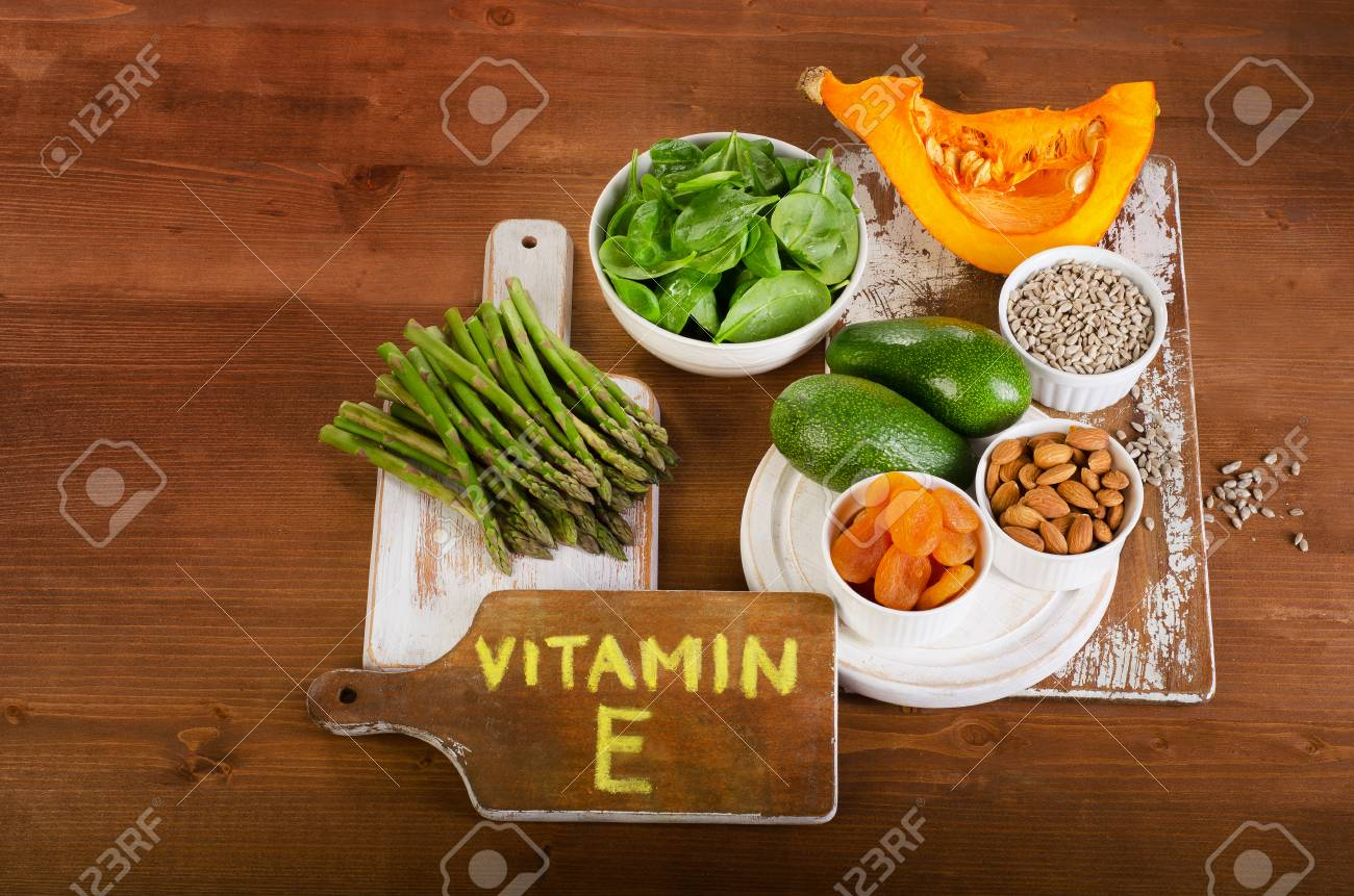 Foods containing vitamin e on wooden background top view stock foods containing vitamin e on wooden background top view stock photo 50447860 workwithnaturefo
