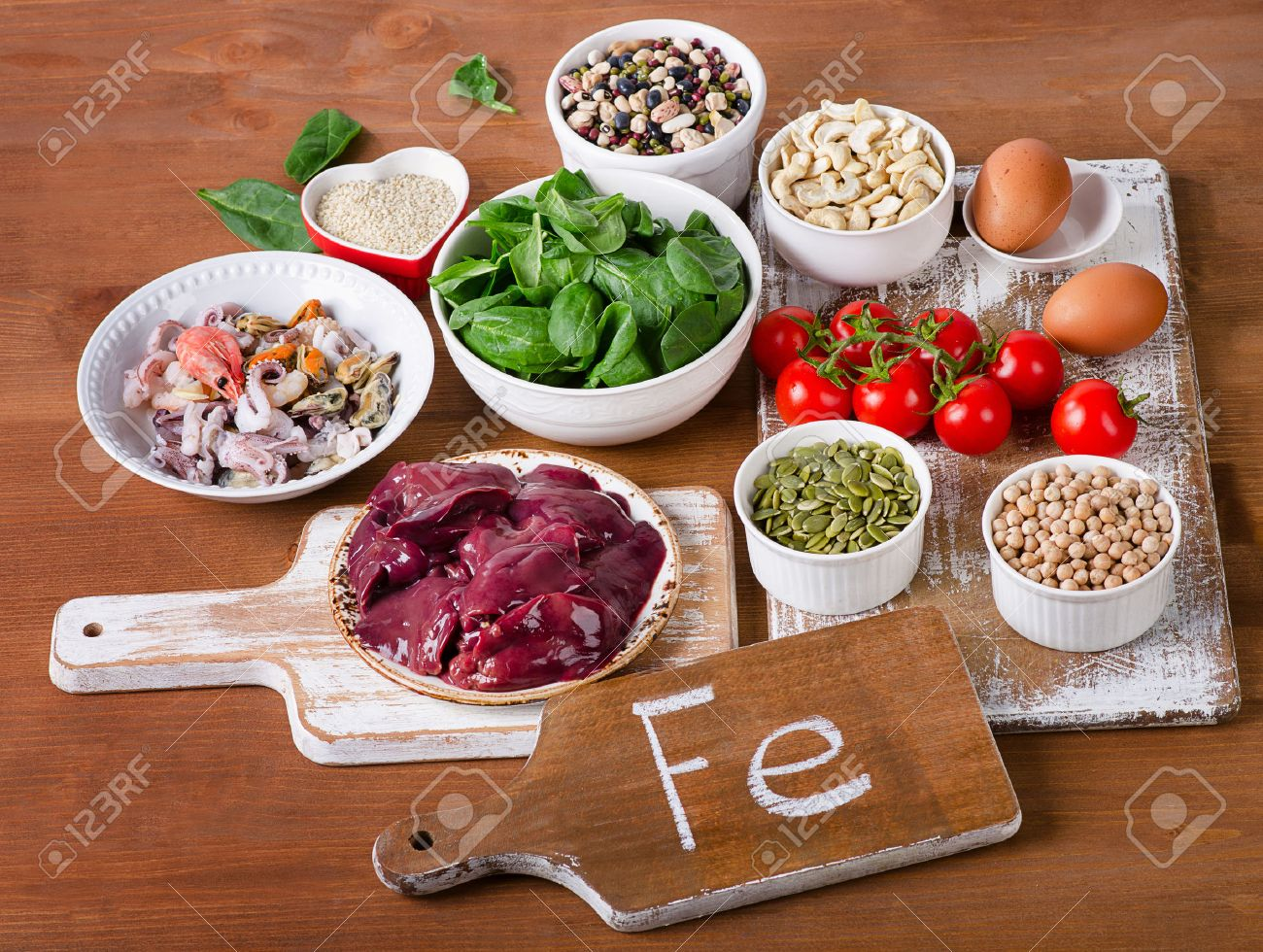 Foods high in Iron, including eggs, nuts, spinach, beans, seafood, liver, chickpeas. - 55559990