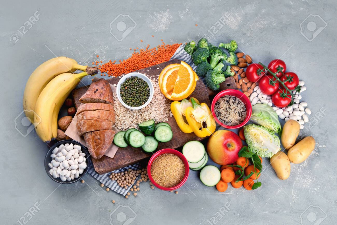 Foods high in carbohydrates on grey background. Vegan Foods high in dietary fiber, antioxidants, vitamins and minerals. Top view, flat lay - 144949164