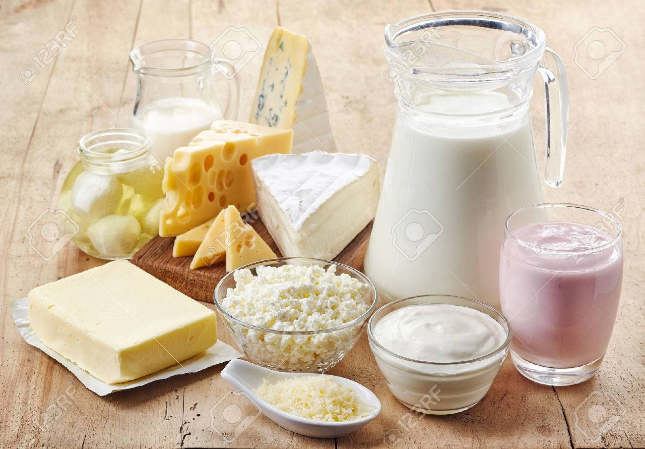 Various fresh dairy products on wooden background - 55868581