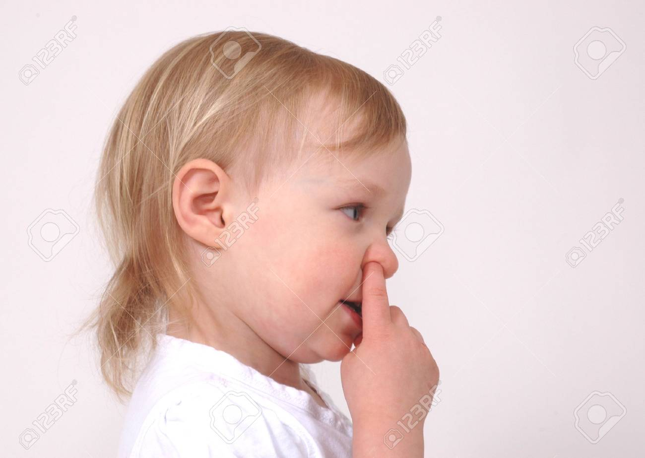 Little girl picks her nose during a photo shoot Stock Photo - 3869758