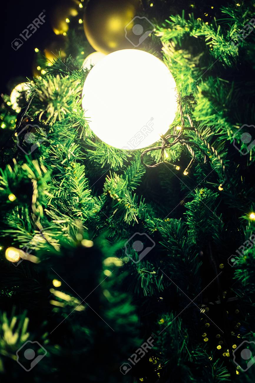 Light Spheres Ornaments Hanging On Christmas Tree Give It Dreamy ...