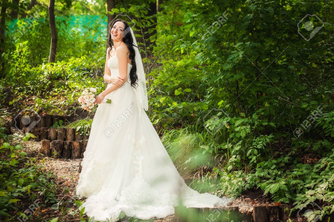 Beauty Bride In White Wedding Dress In Forest With Romantic Sunlight ...