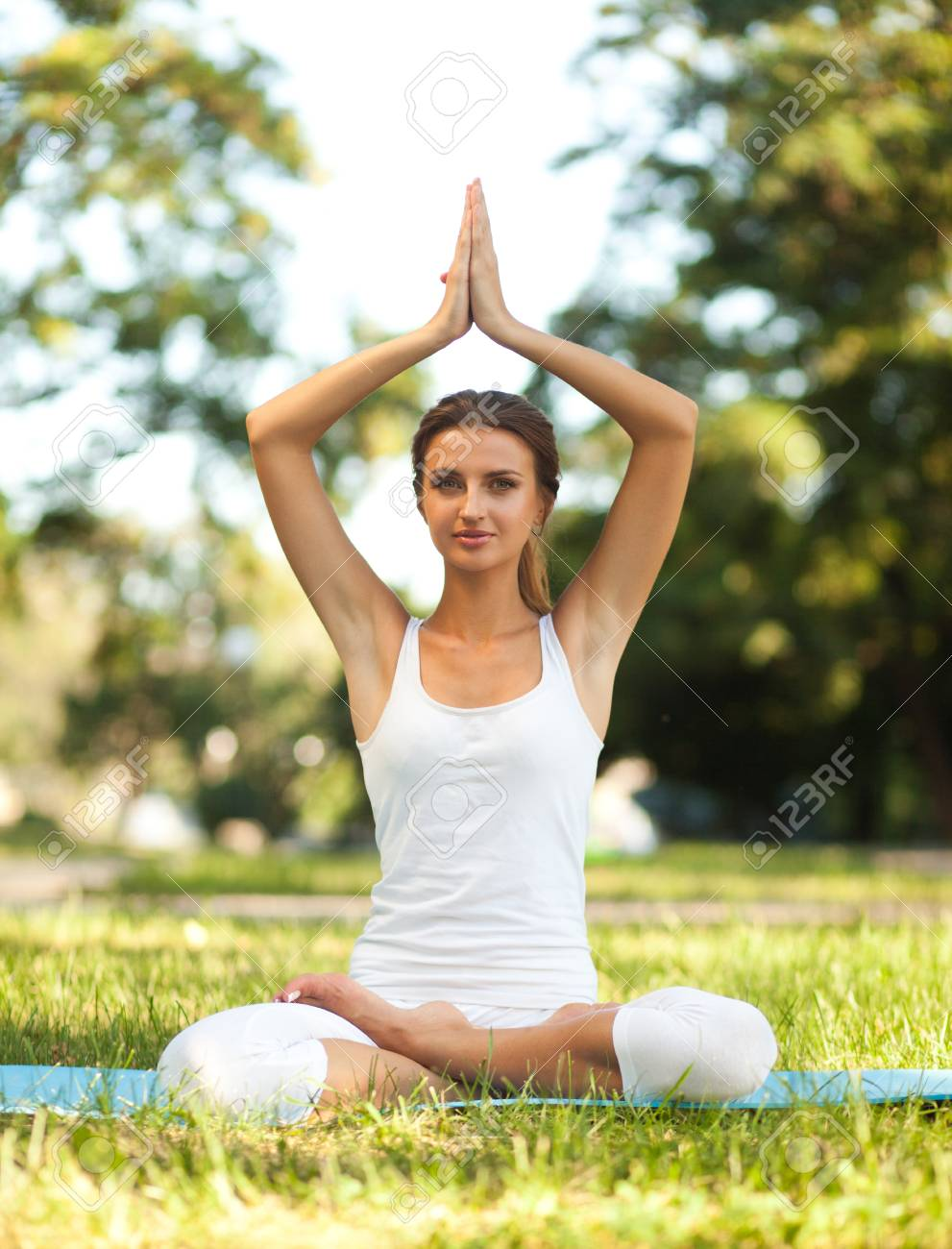 Lotus Pose With Hands Over Head