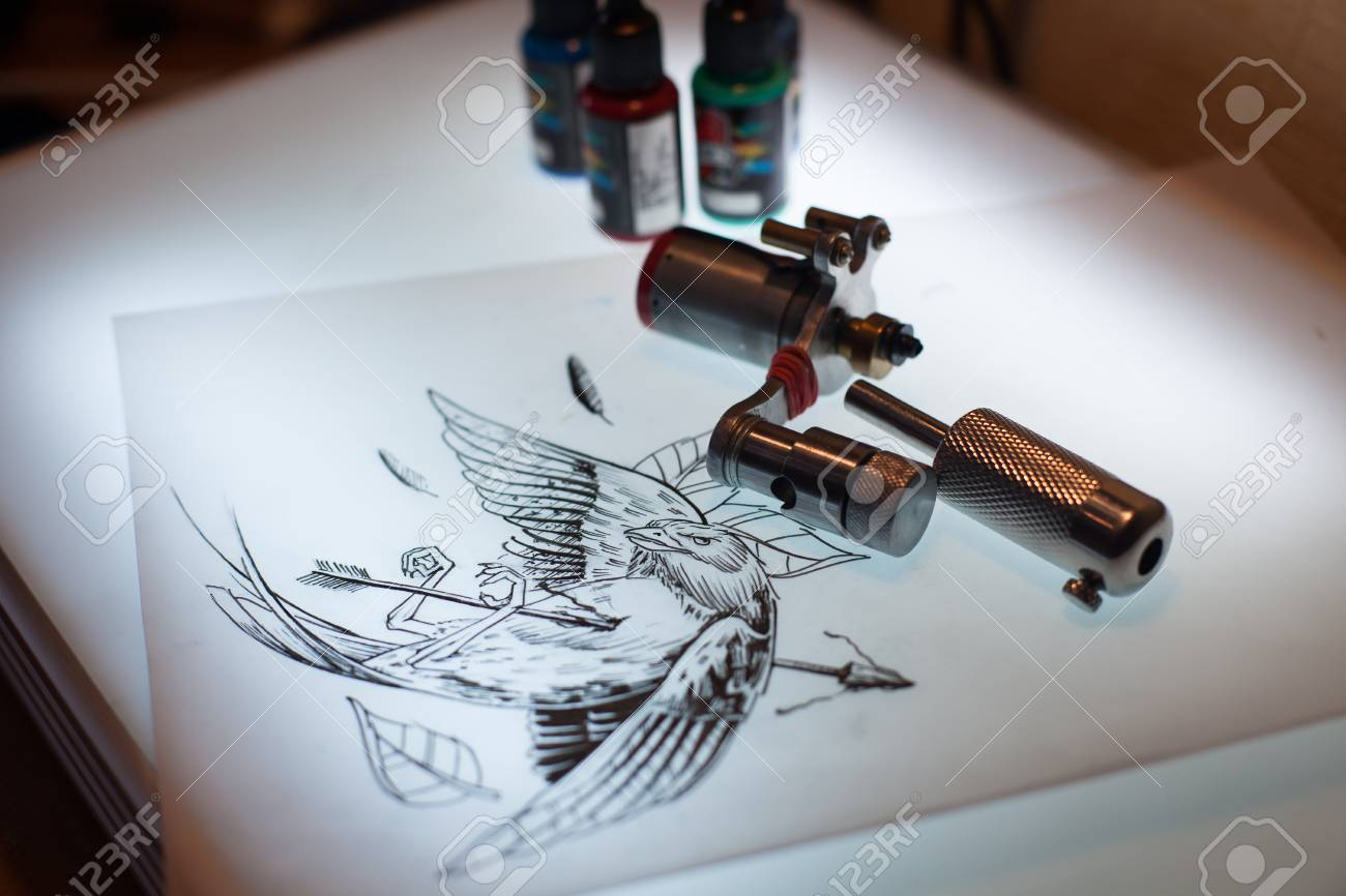 Tattoo equipment and scetch was prepared for making tattoo in stock photo tattoo equipment and scetch was prepared for making tattoo in salon solutioingenieria Gallery
