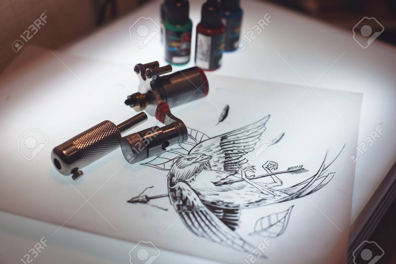 Tattoo equipment and scetch was prepared for making tattoo in stock photo tattoo equipment and scetch was prepared for making tattoo in salon solutioingenieria Choice Image