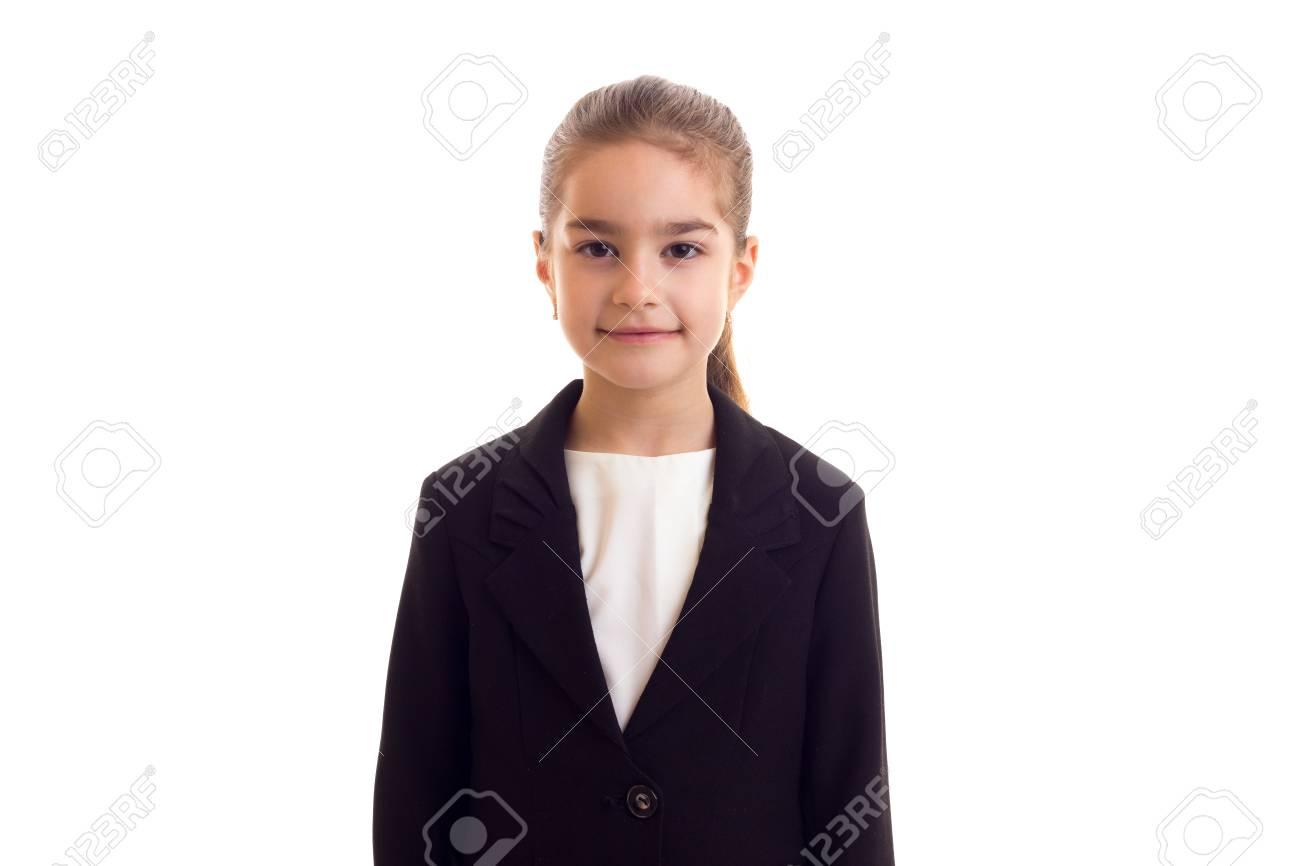 purchase cheap 50fdf e85f7 Piccola ragazza graziosa con coda lunga lunga in maglietta bianca e giacca  nera su sfondo bianco in studio