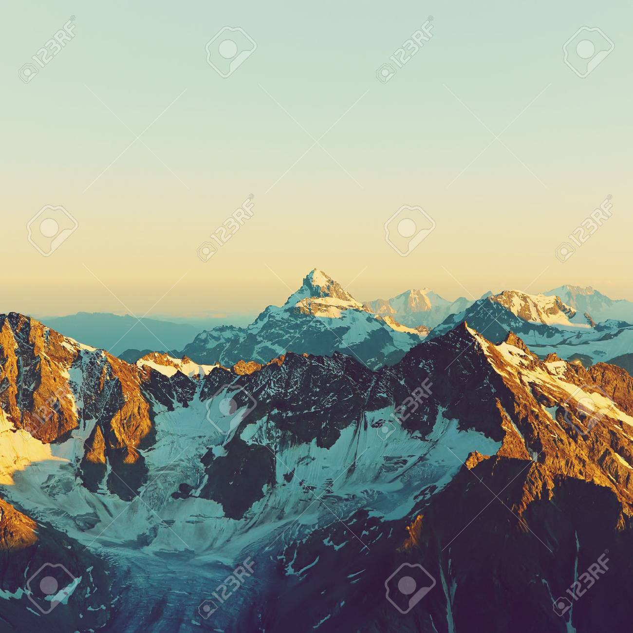 alpine landscape with peaks covered by snow and clouds. natural mountain background Stock Photo - 49138781