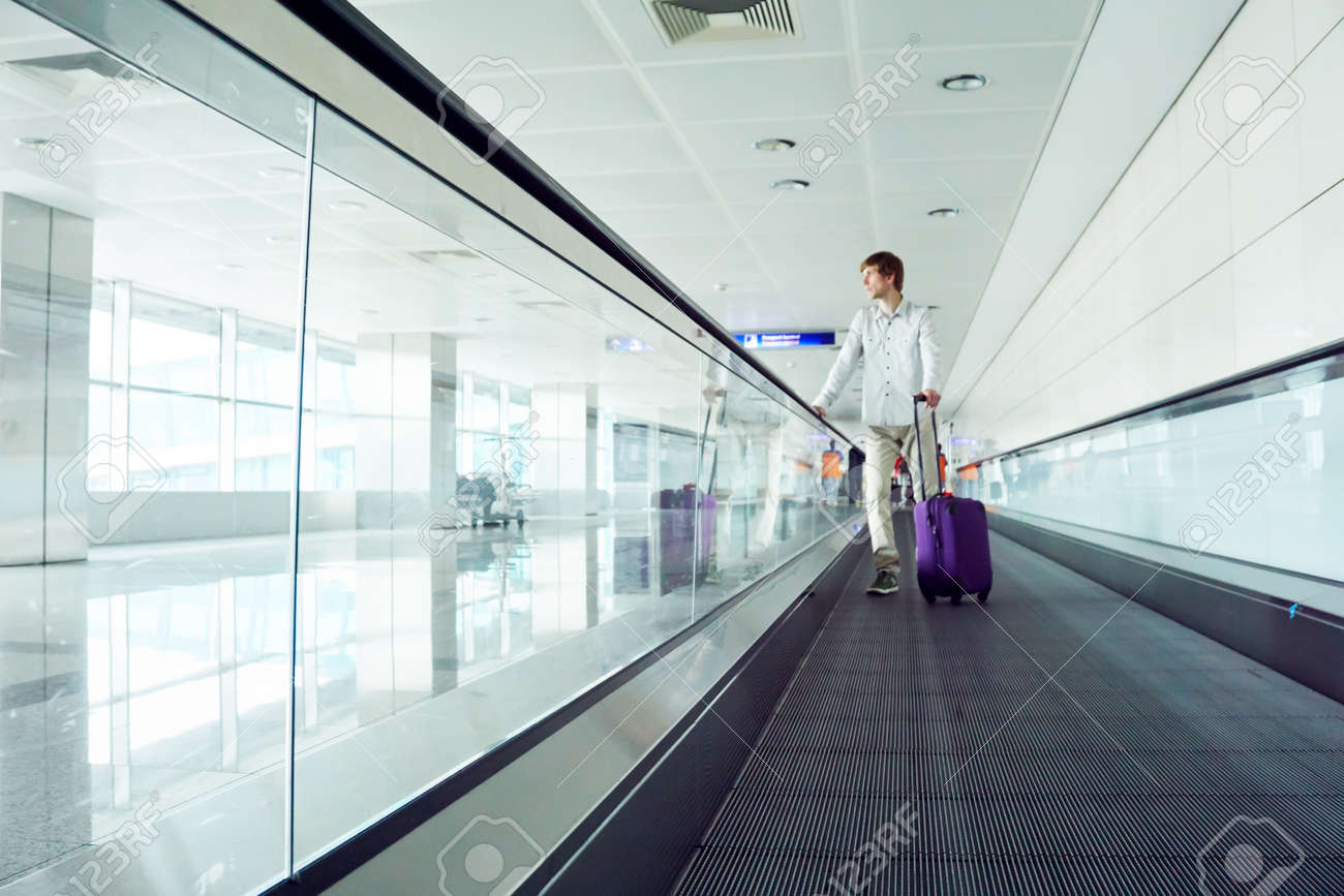 traveler man with a suitcase at airport. - 168381892