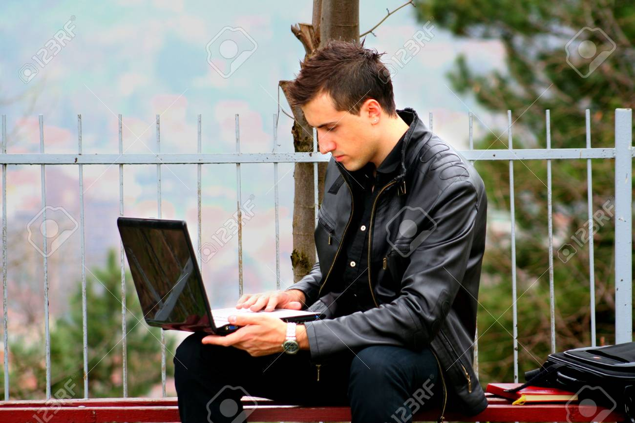 Young Businessman and Laptop 3 Stock Photo - 4628751