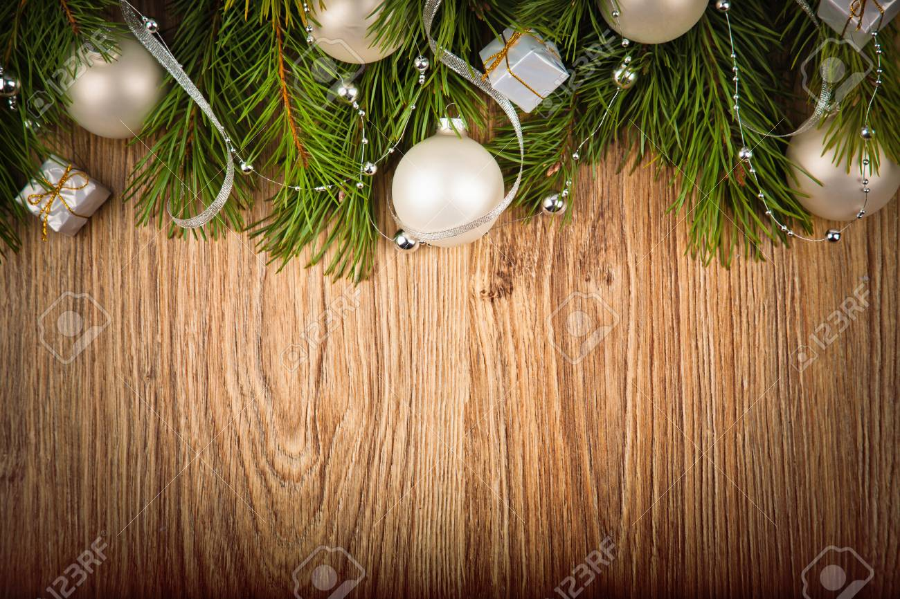 stock photo wooden background with christmas decorations and fir branches