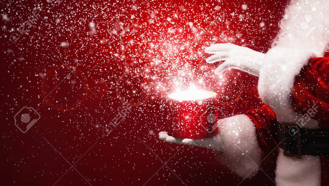 Santa Claus with magic box and snow on red background Standard-Bild - 48710905