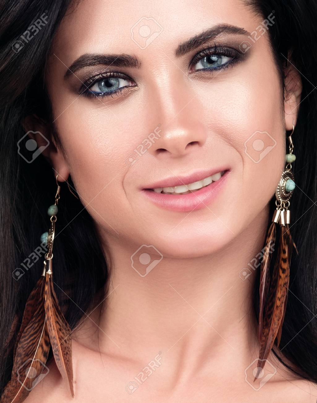 Closeup Portrait Of Young Beautiful Woman Dark Hair Blue Eyes