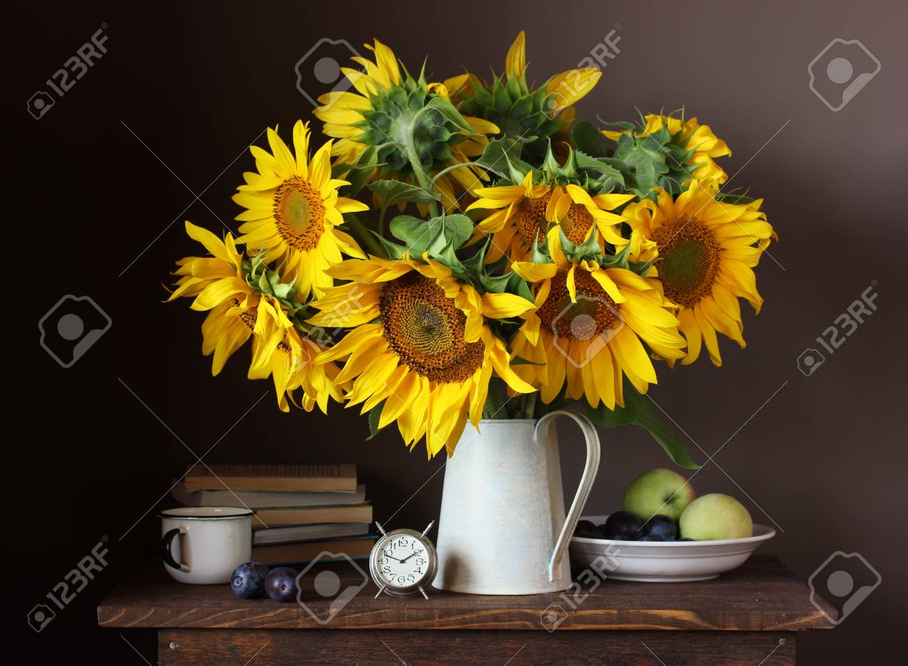 Still Life With A Bouquet Of Yellow Sunflowers And Fruits Flowers Stock Photo Picture And Royalty Free Image Image 110026333