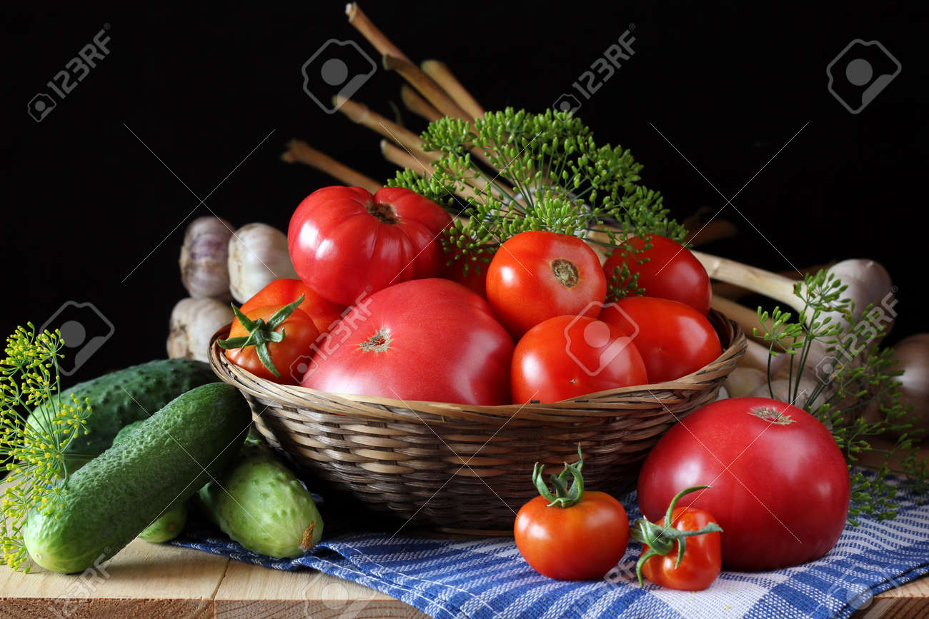 vegetables on the table: cucumbers and tomatoes, dill and garlic. cuisine, summer harvest. - 146947611