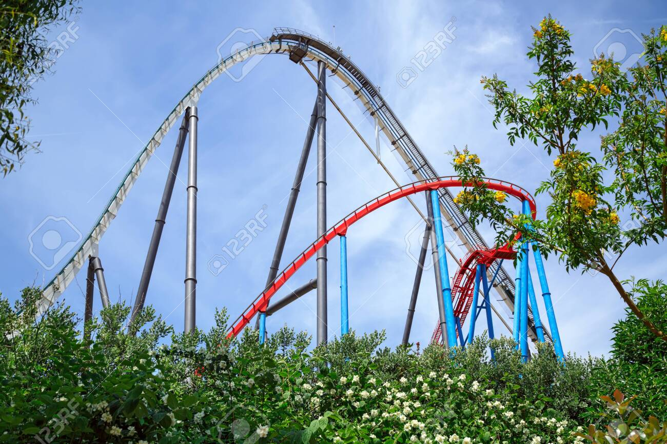 PORT AVENTURA, SPAIN - MAY 11, 2015. Attractions Shambhala and Dragon Khan located in the China theme area of the theme park Port Aventura. City of Salou, Catalonia, Spain. - 135669565