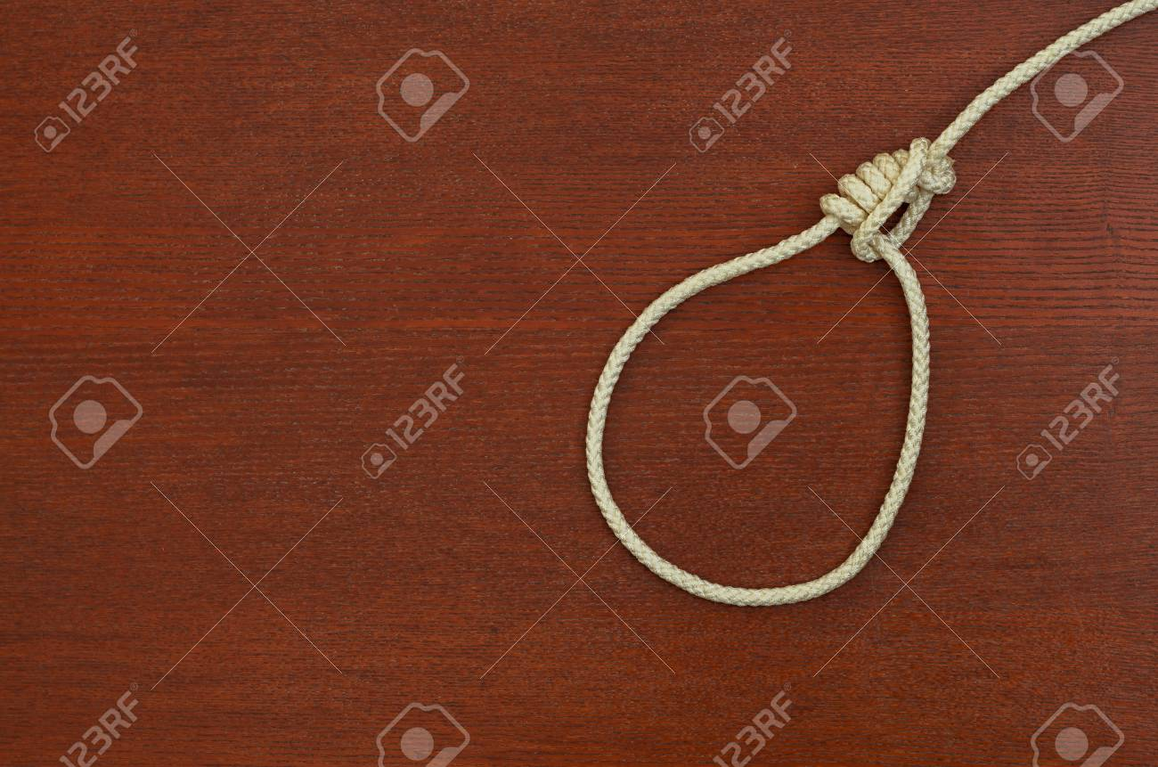 Noose Of Rope On A Wooden Background Stock Photo Picture And