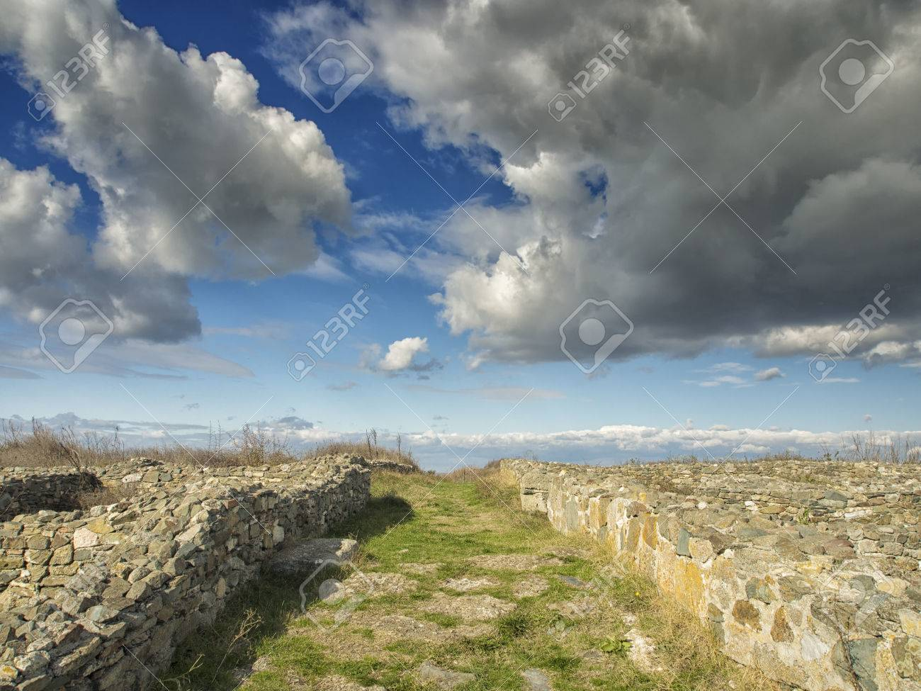 Dramatic Blue Sky With White Clouds Over The Ruins Of The Ancient